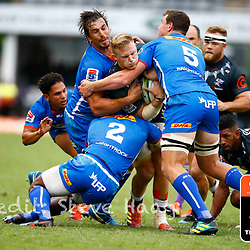 Eben Etzebeth of the DHL Stormers tackling Daniel Du Preez of the Cell C Sharks during the Super Rugby match between Cell C Sharks and DHL Stormers at Jonsson Kings Park on March 02, 2019 in Durban, South Africa. (Photo by Steve Haag)