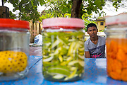 Street food vendor prepares manga achar - pickled pineapple and mango - at his street food stall in Fort Kochi, Cochin, Kerala, Southern India
