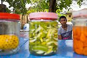 Street food vendor prepares manga achar - pickled pineapple and mango - at his street food stall in Fort Kochi, Cochin, Kerala, Southern India