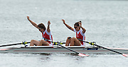Trackai. LITHUANIA. ..Women's Lightweight Double Sculls, Bow Magdalena LOBNIG and Lisa FARTHOFER celebrate winning the Gold medal at the  2012 FISA U23 World Rowing Championships.  Lake Galve. ..11:46:19  Sunday  15/07/2012 [Mandatory Credit: Peter Spurrier/Intersport Images]..Rowing. 2012. U23.