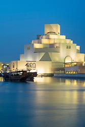 Evening view of illuminated Museum of Islamic Art in Doha Qatar