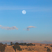 South America, Peru, Laka Titicaca. Full moon (Super moon) over the landscape of Lake Titicaca, Peru.