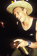 Bez, dancer for the Happy Mondays in straw hat, Ibiza, 1998