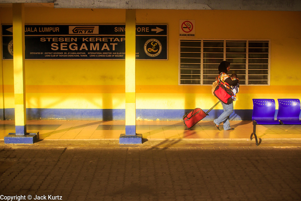 20 DECEMBER 2012 - SEGAMAT, MALAYSIA:  A woman walks through the train station in Segamat, Malaysia, on the line between Singapore and Kuala Lumpur.   PHOTO BY JACK KURTZ