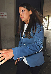 Gayle Newland arrives at Manchester Crown Court where she is due to be sentenced after being found guilty last month of deceiving her female friend into sex by pretending to be a man.