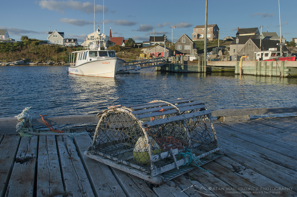 Fishing boat and wooden lobster trap at Peggy's Cove Nova Scotia