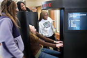 Tahirah Nyanin (from left), Jason Fox, Liz Westendorf and Jasmine Merith check out The Human Race Machine installment at O.U.'s new Baker Center on Tuesday, 1/08/07. The machine morphs the participants' faces to show what they might look like if they belonged to another race.