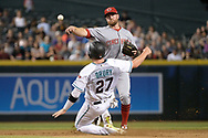 PHOENIX, AZ - JULY 07:  Zack Cozart #2 of the Cincinnati Reds turns the double play over the sliding Brandon Drury #27 of the Arizona Diamondbacks during the sixth inning at Chase Field on July 7, 2017 in Phoenix, Arizona.  (Photo by Jennifer Stewart/Getty Images)