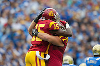 17 October 2012: Wide receiver (15) Nelson Agholor of the USC Trojans catches a pass and scores a touchdown and is hugged by (77) Kevin Graf against the UCLA Bruins during the first half of UCLA's 38-28 victory over USC at the Rose Bowl in Pasadena, CA.