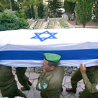 Israeli soldiers carry the coffin of their comrade Nimrod Cohen, 19, during his funeral in Jerusalem July 13, 2006. Hizbollah guerrillas from Lebanon fired barrages of rockets into nearly 20 towns across northern Israel on Thursday, killing one civilian and wounding 42 others in their heaviest bombardment in a decade. Photo by Olivier Fitoussi /Flash90..**RESTRICTED TO ISRAELI MEDIA ONLY** *** Local Caption *** **RESTRICTED TO ISRAELI MEDIA ONLY**