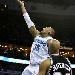Mar 01, 2010; New Orleans, LA, USA; New Orleans Hornets forward David West (30) drives past San Antonio Spurs forward Richard Jefferson (24) during the second half at the New Orleans Arena. The Spurs defeated the Hornets 106-92. Mandatory Credit: Derick E. Hingle-US PRESSWIRE