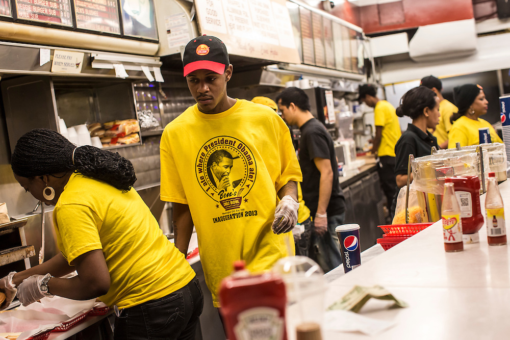 Workers at Ben's Chili Bowl, a local institution which President Barack Obama has visited, wear shirts with the President's photo on them in honor of his Inauguration on Monday, January 21, 2013 in Washington, DC.