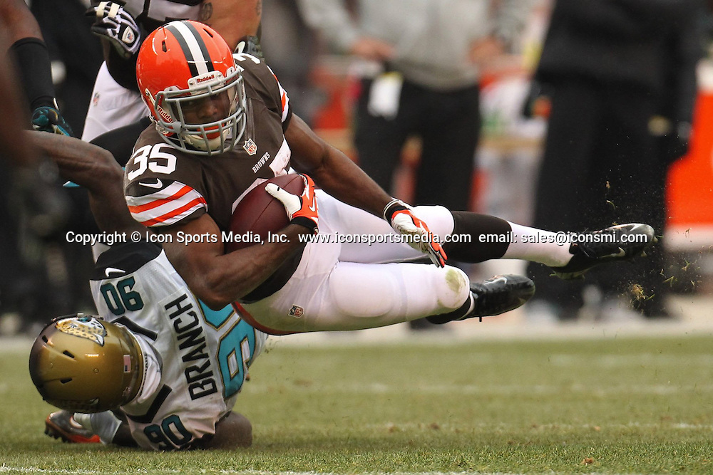 Dec. 1, 2013 - Cleveland, OH, USA - Cleveland running back Fozzy Whittaker, right, is upended by Jacksonville defensive end Andre Branch after a short gain at FirstEnergy Stadium on Sunday, Dec. 1, 2013, in Cleveland, Ohio. The Jaguars defeated the Browns, 32-28