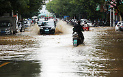 LIUZHOU, Nov. 13, 2015 (Xinhua) -- <br /> <br /> Vehicles run on flooded road in Hezhou City, south China's Guangxi Zhuang Autonomous Region, Nov. 13, 2015. Heavy rainfall in recent days brought flood to many rivers in Guangxi.<br /> ©Exclusivepix Media