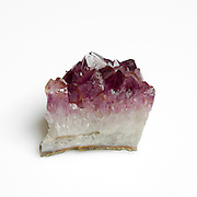 Amethyst crystal on white background
