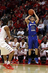 31 December 2014:  Grant Prusator shoots the three before he can be stopped by Tony Wills during an NCAA Division 1 Missouri Valley Conference (MVC) men's basketball game between the Indiana State Sycamores beat the Illinois State Redbirds 63-61 at Redbird Arena in Normal Illinois