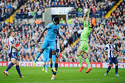 Ben Foster (ENG) of West Brom makes a save from a header by Emmanuel Adebayor (TOG) of Tottenham Hotspur - Photo mandatory by-line: Rogan Thomson/JMP - 07966 386802 - 12/04/2014 - SPORT - FOOTBALL - The Hawthorns Stadium - West Bromwich Albion v Tottenham Hotspur - Barclays Premier League.