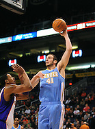 Dec. 22, 2011; Phoenix, AZ, USA; Denver Nuggets center Kosta Koufos (41) reacts on the court against the Phoenix Suns center Channing Frye (8) during a preseason game at the US Airways Center. Mandatory Credit: Jennifer Stewart-US PRESSWIRE.
