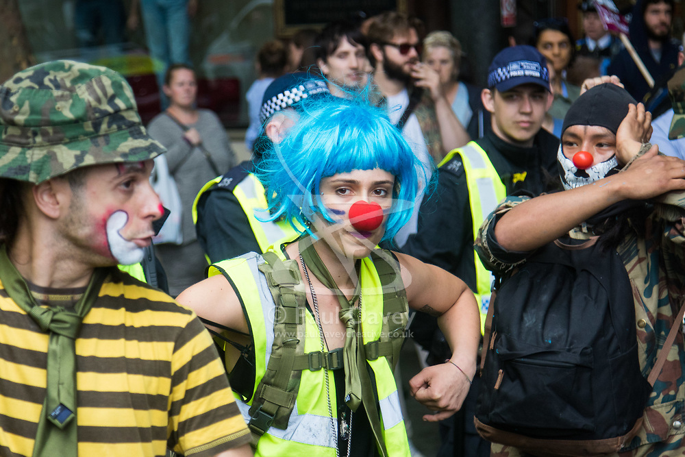 London, June 24th 2017. Anti-fascist protesters counter demonstrate against a march to Parliament by the far right anti-Islamist English Defence League. PICTURED: Antifascist clowns get up to mischief at a police line.