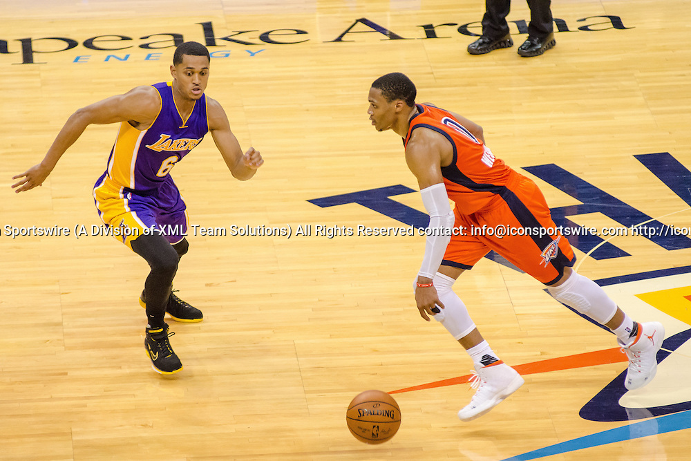OKLAHOMA CITY, OK - OCTOBER 30:   Oklahoma City Thunder Guard Russell Westbrook (0) brings the ball up court on a fast break while Los Angeles Lakers Guard Jordan Clarkson (6) plays defense. October 30, 2016, at the Chesapeake Energy Arena Oklahoma City, OK. (Photo by Torrey Purvey/Icon Sportswire)