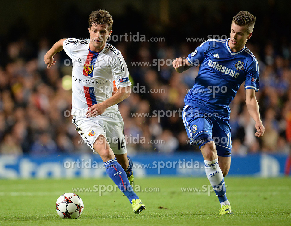 18.09.2013, Stamford Bridge, London, ENG, UEFA Champions League, FC Chelsea vs FC Basel, Gruppe E, im Bild Basel's Valentin Stocker and Chelsea's Marco van Ginkel  during UEFA Champions League group E match between FC Chelsea and FC Basel at the Stamford Bridge, London, United Kingdom on 2013/09/18. EXPA Pictures © 2013, PhotoCredit: EXPA/ Mitchell Gunn <br /> <br /> ***** ATTENTION - OUT OF GBR *****