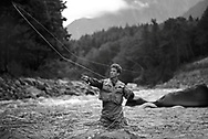 San Diego Lifestyle Photographer, San Diego Lifestyle Photographers, Lifestyle Photoshoot of Fly Fisherman in waders casting his line in the Skykomish River in Washington State.
