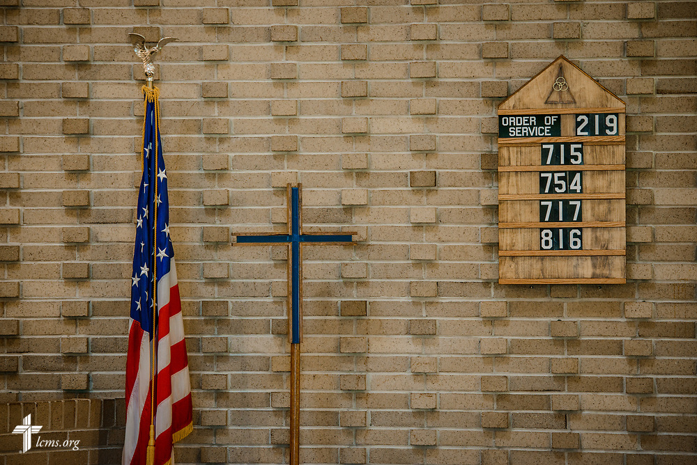 The order of service, cross and United States Flag at Benediction Lutheran Church, Milwaukee, Wis., on Monday, Aug. 14, 2017. LCMS Communications/Erik M. Lunsford