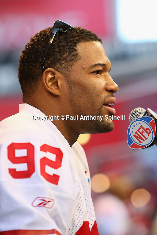 GLENDALE, AZ - JANUARY 29: Defensive end Michael Strahan #92 of the New York Giants speaks to the media at the Giants Super Bowl XLII Media Day at University of Phoenix Stadium on January 29, 2008 in Glendale, Arizona.©Paul Anthony Spinelli *** Local Caption *** Michael Strahan