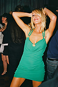 Blonde girl in green dress posing n the dancefloor, Posh at Addington Palace, UK, August, 2004