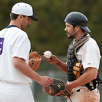 25 April 2010: Benjamin Deruelle talks to Phil Davis of the PUC as he pitches against Rouen during game 2/week 3 of the French Elite season won 12-0 by Rouen over the PUC, at the Pershing Stadium in Vincennes, near Paris, France.