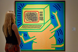 "© Licensed to London News Pictures. 28/06/2017. London, UK.  A visitor views ""Untitled, April 12, 1984"" by Keith Haring.  Preview day at Masterpiece London, a leading art fair held in Chelsea, bringing together 150 international exhibitors presenting works from antiquity to the present day.  The event runs 29 June to 5 July 2017.   Photo credit : Stephen Chung/LNP"