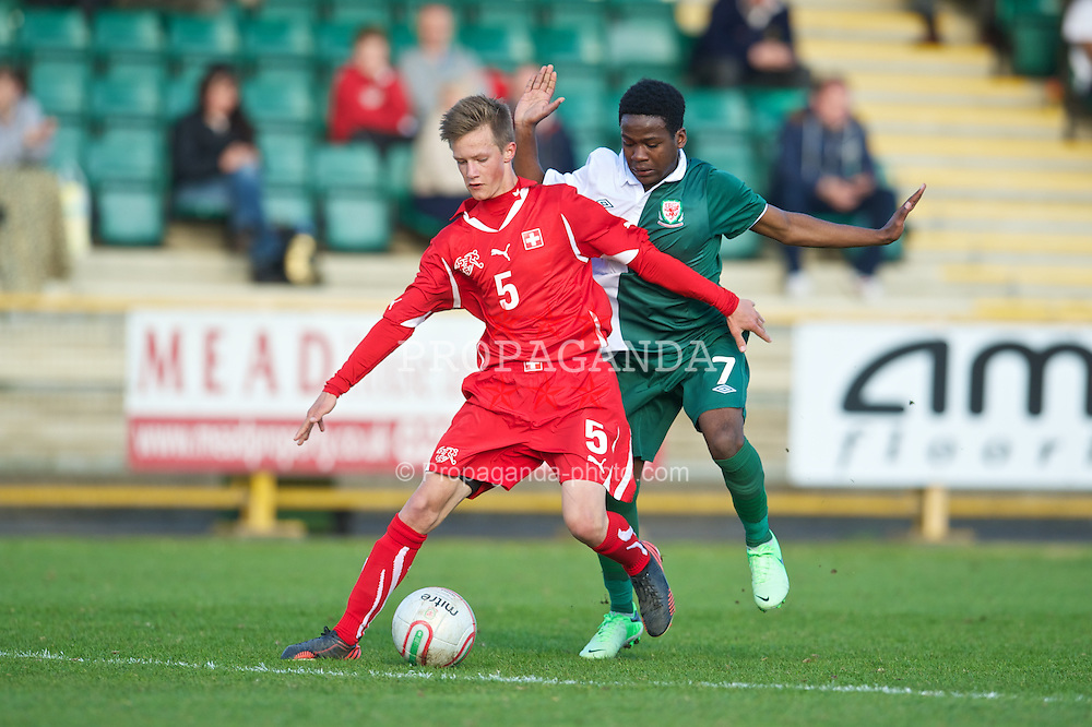 BARRY, WALES - Tuesday, April 30, 2013: Wales' Elijah Chilekwa in action against Switzerland's Joel Zahn during the Under-15's International Friendly match at Jenner Park. (Pic by David Rawcliffe/Propaganda)