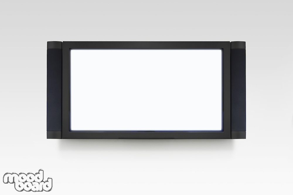 Flat screen television on white wall