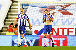 Wigan Athletic players look dejected after conceding the opening goal - Mandatory by-line: Matt McNulty/JMP - 03/02/2017 - FOOTBALL - DW Stadium - Wigan, England - Wigan Athletic v Sheffield Wednesday - Sky Bet Championship