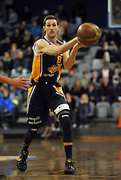 Luke Aston passes, in  the NBL match, between the Otago Nuggets and Manawatu Jets, Lion Foundation Arena, Edgar Centre, Dunedin, Otago, New Zealand, Saturday, June 8, 2013. Credit: Joe Allison / Allison Images