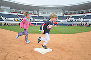Fans run the bases following Mississippi vs. Louisville at Oxford-University Stadium in Oxford, Miss. on Sunday, March 14, 2010. Louisville won 10-8.