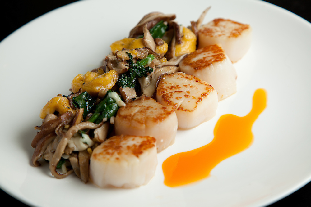 Seared scallops with butternut squash gnudi, shitake mushrooms, spinah and paprika photographed at Market GRill in Soulard in St. Louis MO.