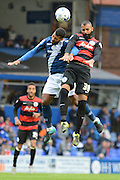 Birmingham City midfielder David Davis and Queens Park Rangers midfielder Sandro challenge for the ball during the Sky Bet Championship match between Birmingham City and Queens Park Rangers at St Andrews, Birmingham, England on 17 October 2015. Photo by Alan Franklin.