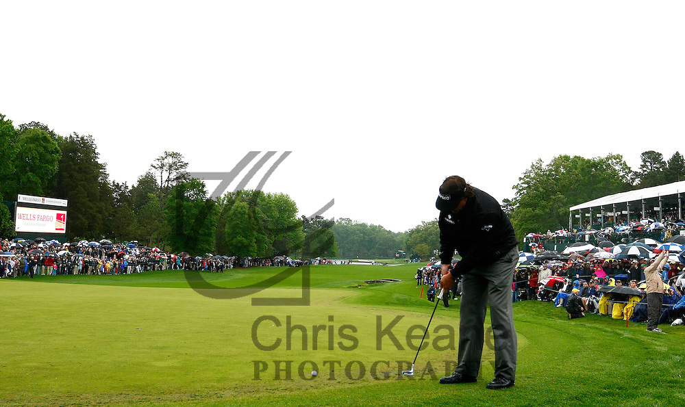 Phil Mickelson of the U.S. watches his putt on the 18th hole during the final round of the Wells Fargo Championship at the Quail Hollow Club in Charlotte, North Carolina on May 5, 2013.  (Photo by Chris Keane - www.chriskeane.com)