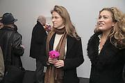 Olga Konoschuk and Caroline Navarro. Yinka Shonibare MBE, Flower Time. Private view at the Stephen Friedman Gallery.  Old Burlington St.  London 30 November 2006.   ONE TIME USE ONLY - DO NOT ARCHIVE  © Copyright Photograph by Dafydd Jones 248 CLAPHAM PARK RD. LONDON SW90PZ.  Tel 020 7733 0108 www.dafjones.com
