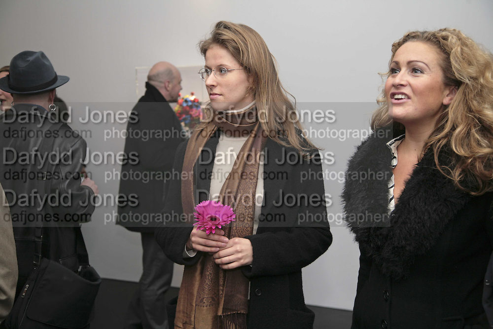 Olga Konoschuk and Caroline Navarro. Yinka Shonibare MBE, Flower Time. Private view at the Stephen Friedman Gallery.  Old Burlington St.  London 30 November 2006.   ONE TIME USE ONLY - DO NOT ARCHIVE  © Copyright Photograph by Dafydd Jones 248 CLAPHAM PARK RD. LONDON SW90PZ.  Tel 020 7733 0108 www.dafjones.com