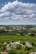 Spectacular far-reaching views over picturesque Dartmoor in Devon - rocks, blue sky and puffy clouds, England, UK