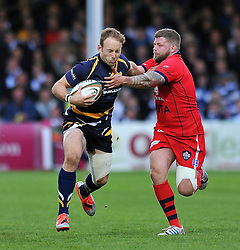 Chris Pennell of Worcester Warriors looks to fend Chris Brooker of Bristol Rugby - Photo mandatory by-line: Patrick Khachfe/JMP - Mobile: 07966 386802 27/05/2015 - SPORT - RUGBY UNION - Worcester - Sixways Stadium - Worcester Warriors v Bristol Rugby - Greene King IPA Championship Play-off Final (Second leg)