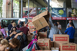 London, June 15th 2017. Mountains of food and clothing donated to the many people who have lost everything and been made homeless in the Grenfell Tower fire of June 14th, by generous Londoners are stored on a basketball court at the Westway Sports Centre.