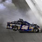 NASCAR Sprint Cup driver Martin Truex Jr. (56)  wrecks<br /> during the NASCAR Coke Zero 400 Sprint series auto race at the Daytona International Speedway on Saturday, July 6, 2013 in Daytona Beach, Florida.  (AP Photo/Alex Menendez)