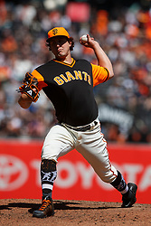 SAN FRANCISCO, CA - AUGUST 26: Derek Holland #45 of the San Francisco Giants pitches against the Texas Rangers during the fifth inning at AT&T Park on August 26, 2018 in San Francisco, California. The San Francisco Giants defeated the Texas Rangers 3-1. All players across MLB will wear nicknames on their backs as well as colorful, non-traditional uniforms featuring alternate designs inspired by youth-league uniforms during Players Weekend. (Photo by Jason O. Watson/Getty Images) *** Local Caption *** Derek Holland