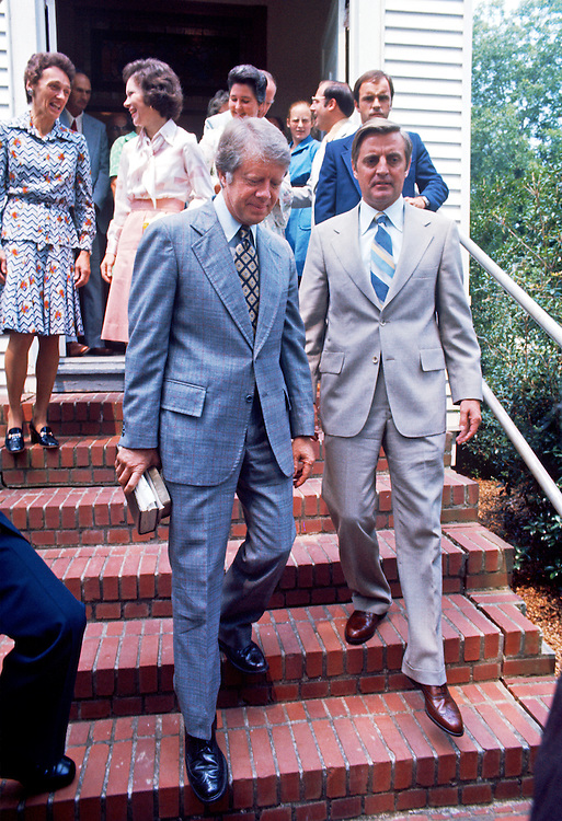 President Jimmy Carter and Vice President Walter Mondale walk from Sunday services at the Plains Baptist Church. They are joined by their wives Rosalyn Carter and Joan Mondale. - To license this image, click on the shopping cart below -