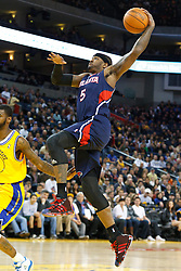 February 25, 2011; Oakland, CA, USA;  Atlanta Hawks power forward Josh Smith (5) jumps for a dunk against the Golden State Warriors during the first quarter at Oracle Arena.