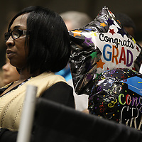 A mother has her balloons ready for her graduate at Saturday's ceremony for Nettleton High School.