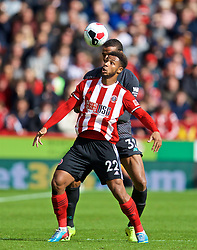 SHEFFIELD, ENGLAND - Thursday, September 26, 2019: Sheffield United's Lys Mousset and Liverpool's Joel Matip during the FA Premier League match between Sheffield United FC and Liverpool FC at Bramall Lane. (Pic by David Rawcliffe/Propaganda)